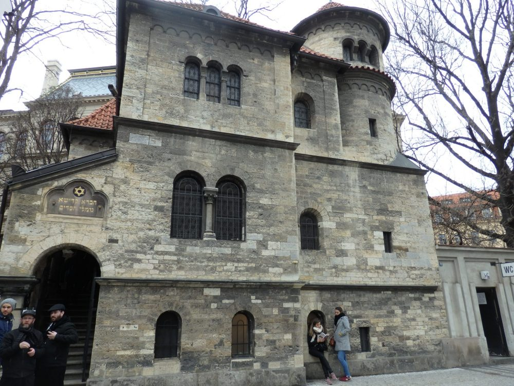 The Ceremonial Hall is right next to the Old Jewish Cemetery and on the Jewish Museum's route of the synagogues in Prague. It has three main stories and an additional small cupola in one corner. The building is made of stone bricks. The windows are small and arched. The entrance is arched as well, and is on the far left of the building.