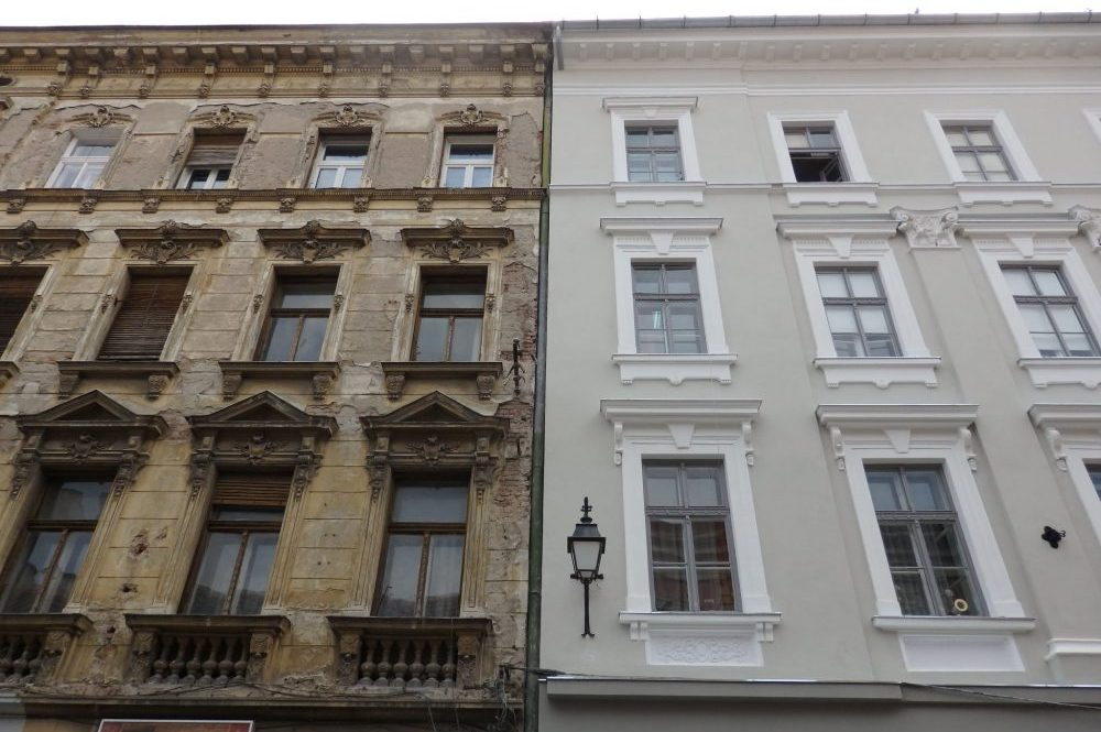 Look at the contrast between the unrestored building on the left and the restored one on the right. Faded Glory in TImisoara, Romania