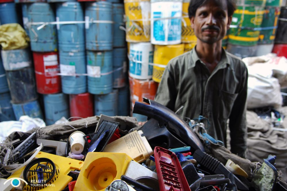 A plastics worker in Dharavi slum. Photo courtesy of Reality Tours.