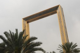 The Dubai Frame, in this picture, looks like it's just behind the palm trees, and only two or three stories high!