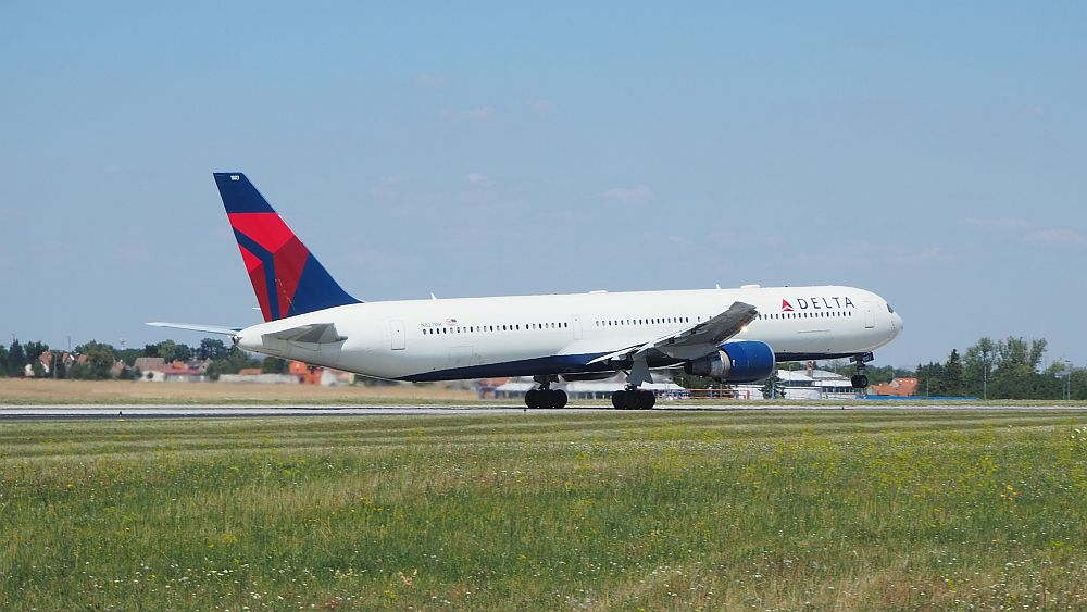 A Delta flight, just after it sped past us and just as it started to lift off the runway at Prague Airport.