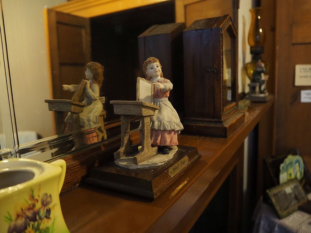 """Detail from one of the overcrowded rooms at the Wick Heritage Museum. My mother called items like these that sit on shelves and collect dust """"chotchkes""""."""