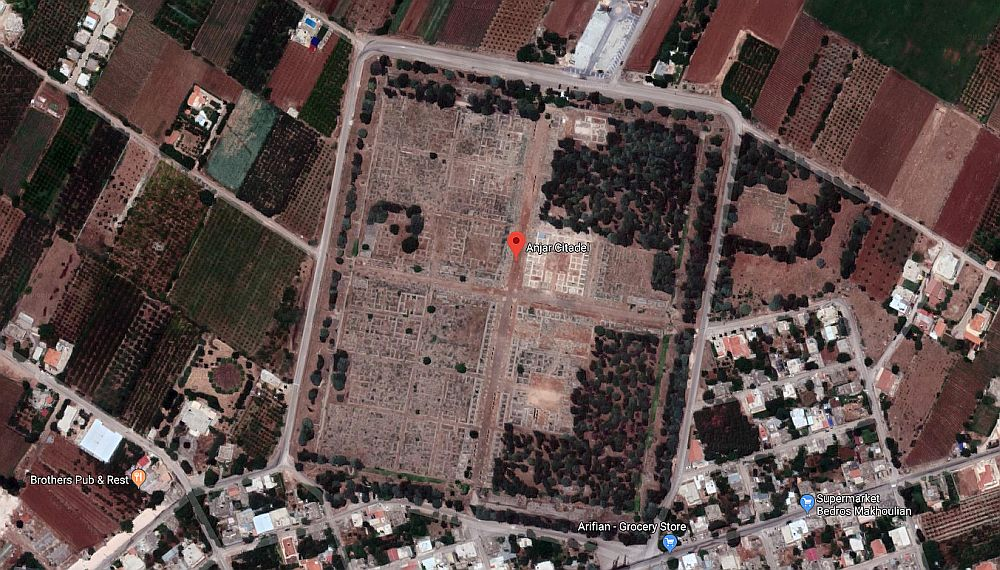 The satellite view shows a neat square, divided in four by roads, and each of those squares shows the outlines of square buildings.