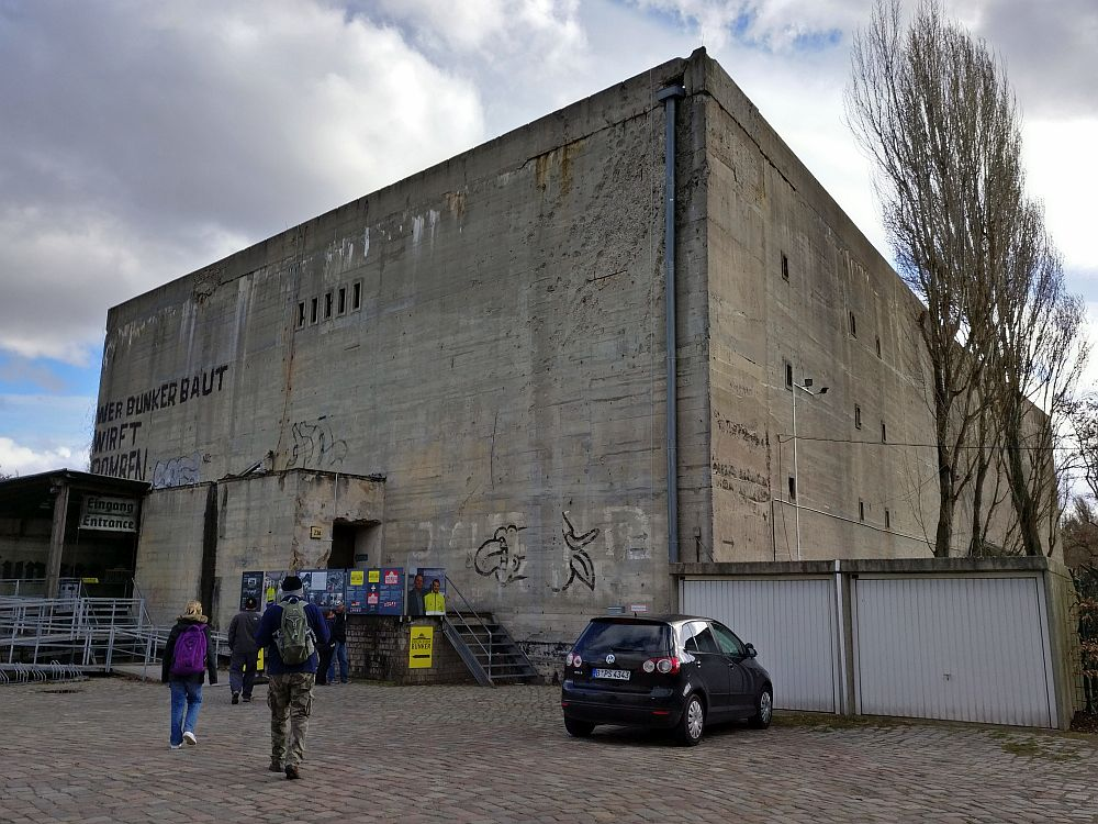 The Berlin Story Bunker, a WWII site in Berlin, is a looming, square, concrete structure with only a few ventilation openings rather than windows.