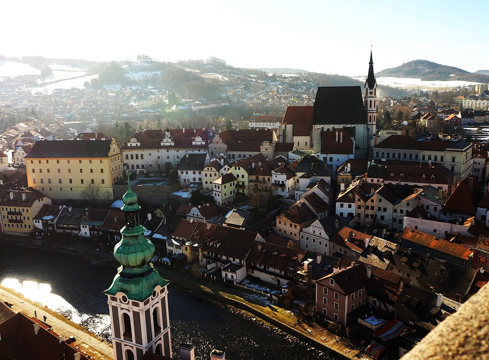 The town from here looks like a crowded huddle of small buildings, with St. Vitus Church above them.
