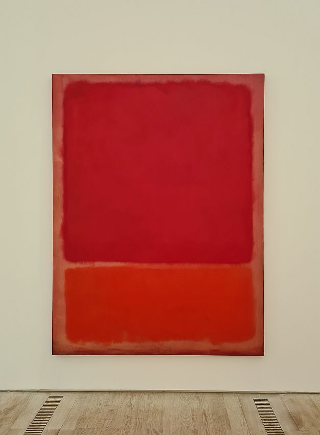 Like most Rothkos, the painting is very simple, with two squares of color: red above and an orangy-red below.