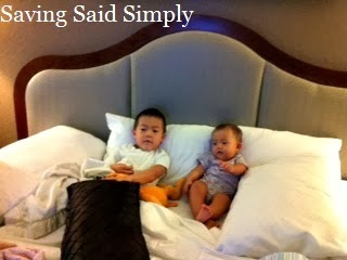 Kids laying in hotel bed