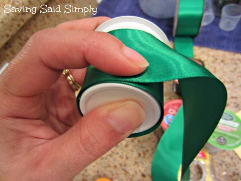 Covering K-Cup with green ribbon