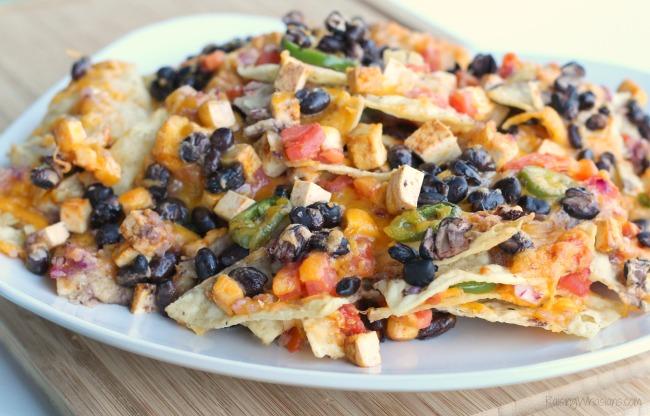 Easy vegetarian nachos Loaded Vegetarian Nachos Recipe | Easy to make and protein packed Vegetarian Nachos Recipe, perfect for game day! Smoky Chipotle flavor with Nasoya Tofu #Recipe #GameDayRecipe #VegetarianRecipe