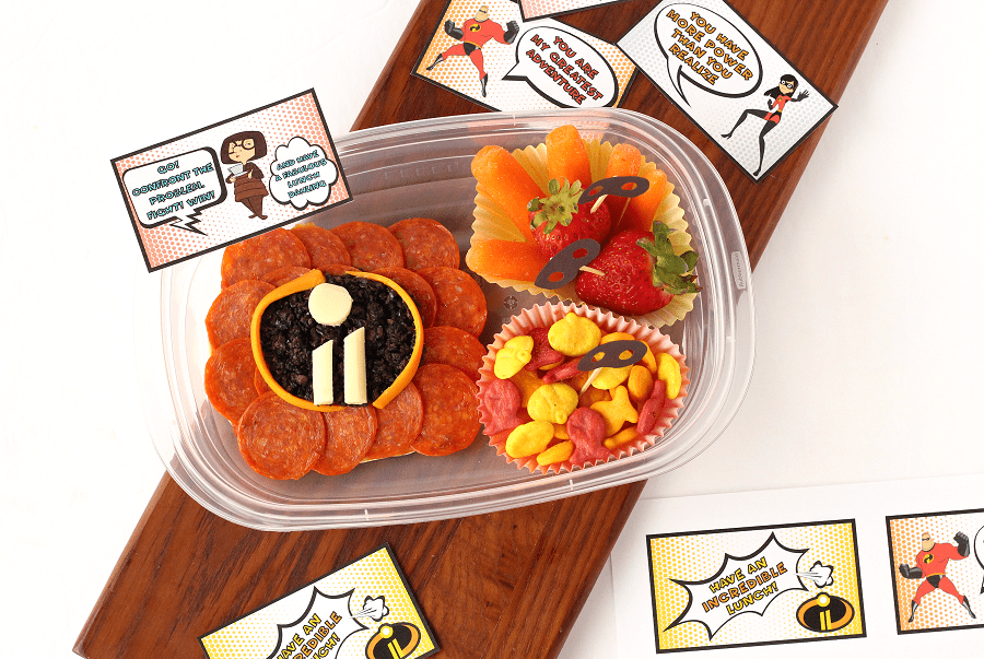 FREE Incredibles 2 Lunch Notes Printable + Incredible Bento Box Idea | Get ready for Disney Pixar's Incredibles 2 movie with this fun & easy kids lunch idea + free lunchbox notes featuring Mr. Incredible, Elastigirl, Edna & more. #Incredibles2 #FrigoCheeseHeads #Disney #FreePrintables #lunchbox #BentoBox