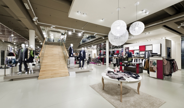 Carnaby Fashion House by Shop Consult   Umdasch Shopfitting  Wiener     By intertwining floor and cubes the play of smooth transition is continued  in the accessories and shoes area  This area is designed entirely in white  and