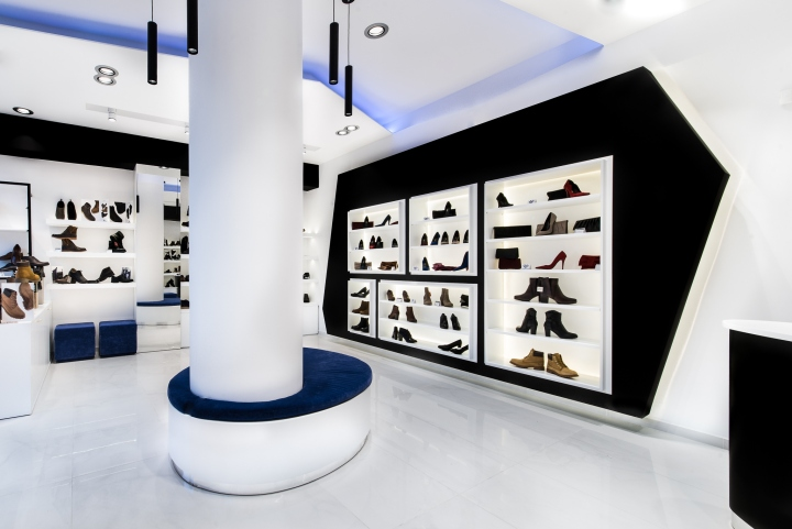 Georgantas Shoes by SmART interiors  Athens     Greece Our interior design office smartly used the height of the restaurant and  created an elaborate ceiling with hanging lamps  backlight blue tint and  black