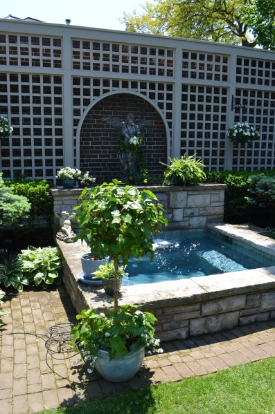 Ministry of the fence 6 transforming garden ideas from elegant to     A hot tub acting as a garden focal point