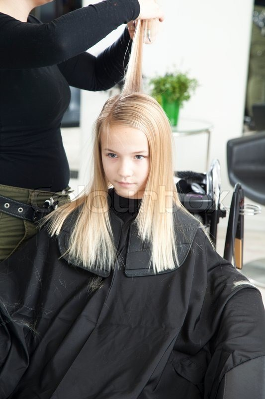 The Best A Young Girl Getting A New Haircut In A Stock Photo Pictures