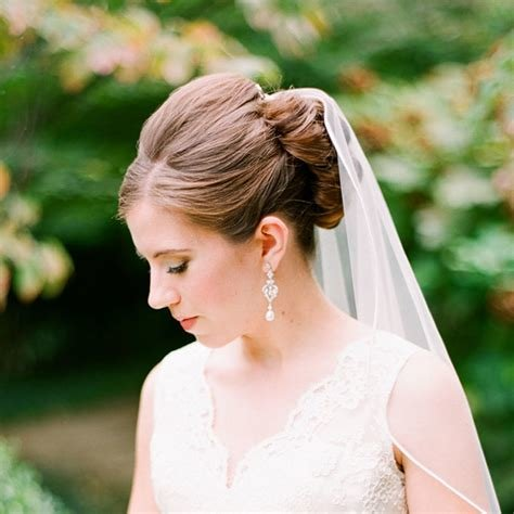 The Best Wedding Hairstyles That Work Well With Veils Brides Com Pictures