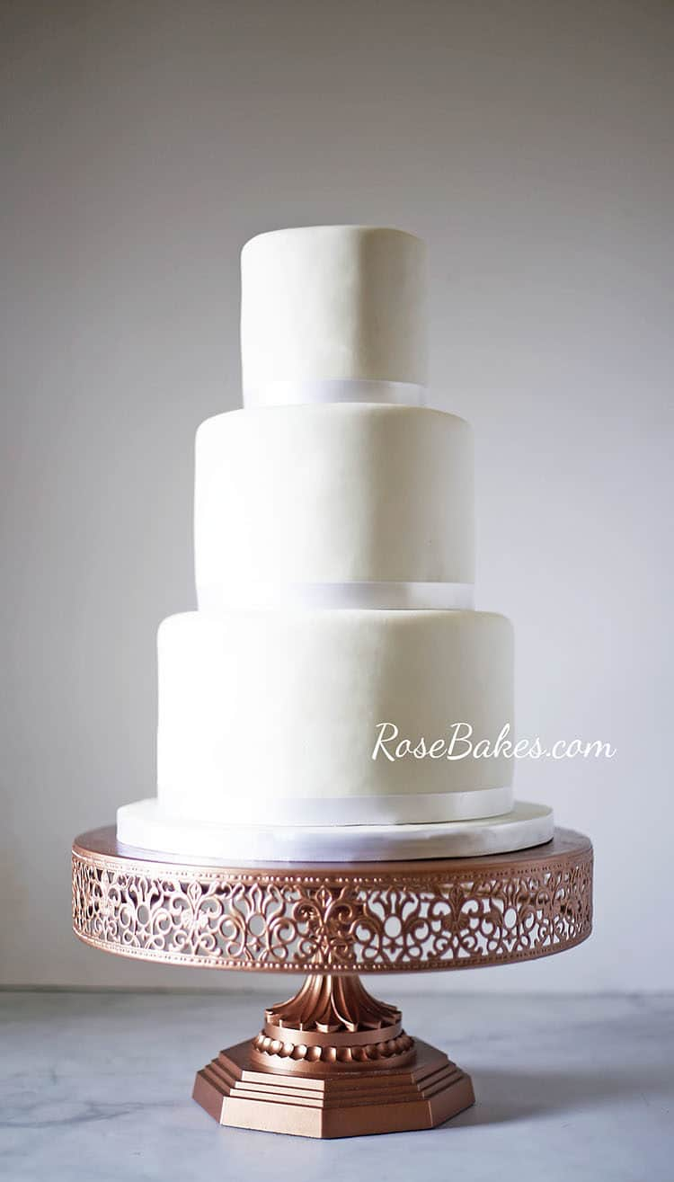 Simple White Wedding Cake on Different Cake Stands   Rose Bakes I instantly fell madly in love with this gorgeous cake stand and was so  exited for a chance to photograph it with this cake  Isn t it stunning