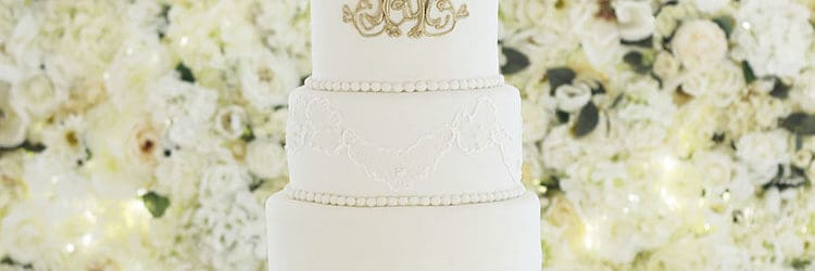 Elegant Tall Lace Wedding Cake with Gold Monogram   Rose Bakes Elegant Tall Lace Wedding Cake with Gold Monogram