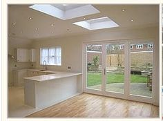 This Attractive Patio Enclosure With Folding Doors Would