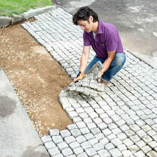 Laying Over Dirt Pavers