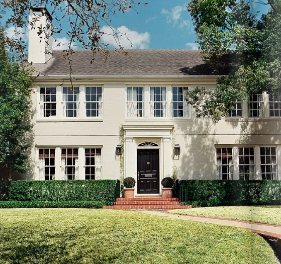 Traditional Painted Brick Lots Of Windows Glossy Black