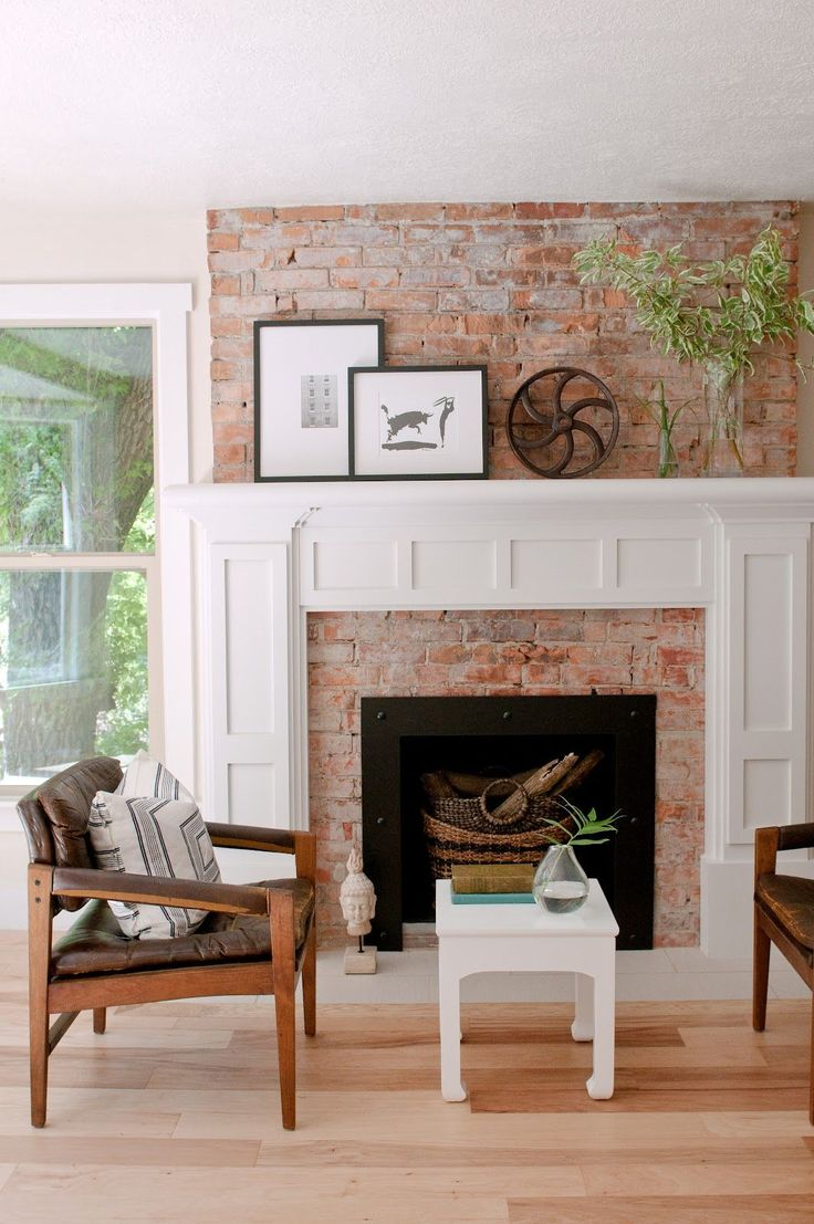Exposed Brick Fireplace With White Painted Mouldings And