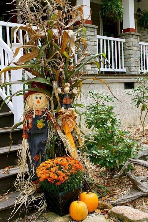 Cute Autumn Decor Of A Scarecrow Wheat Pumpkins And
