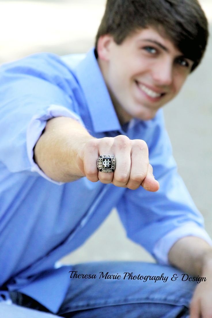 Senior Photography Superman Pose With Class Ring Senior
