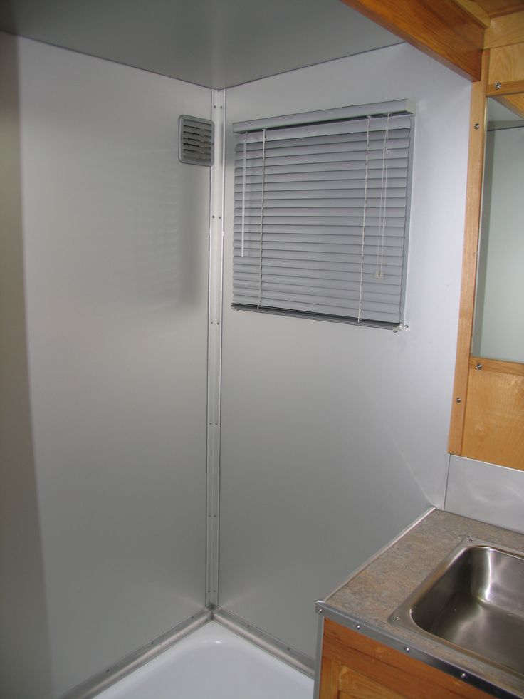 New Aluminum Walls Replaced Old Laminate Shower Walls In