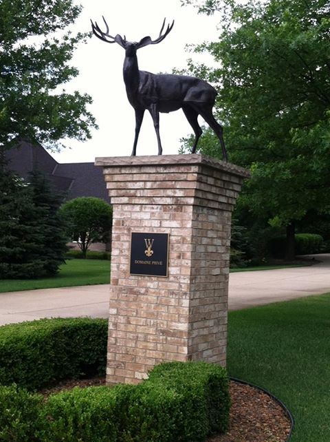 Really Cool Deer Statue That Sits On Top Of A Pillar At