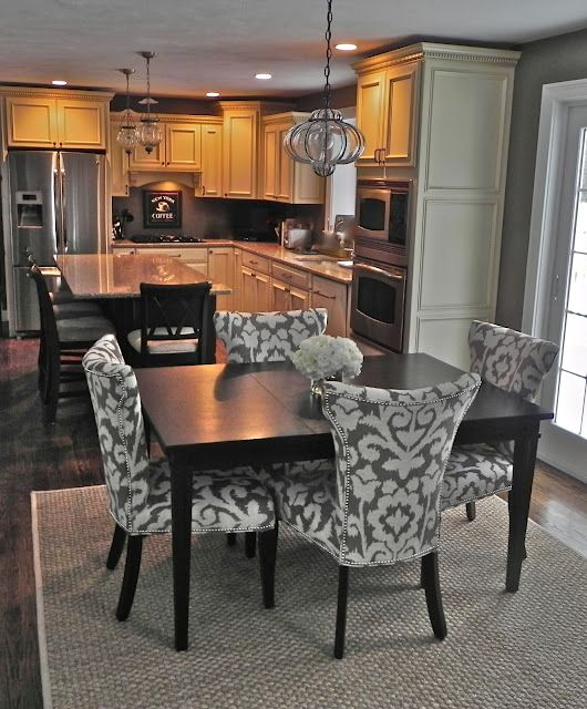 Remodeled Kitchen With Island And Dining Room