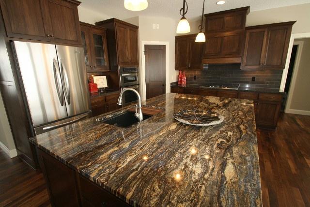 Ldk Kitchen With Cinderella Blue Granite Island Top Walnut Stained Cabinets And Walnut Flooring