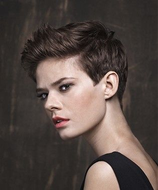 A short brown straight tomboy hairstyle by Trevor Sorbie ...