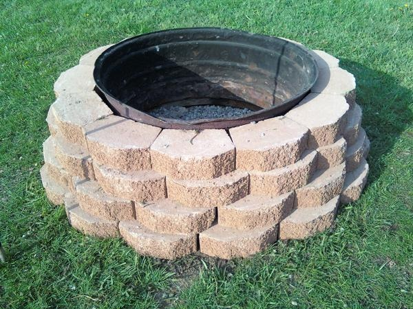 Firepit Made With Castle Rock And An Old Tractor Tire Rim