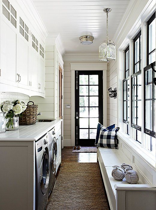 Beautiful Black And White Entryway With Laundry Room