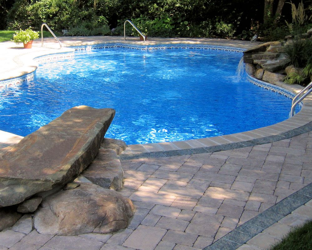 Pool With Dive Rock Water Fall And Detailed Paving Design