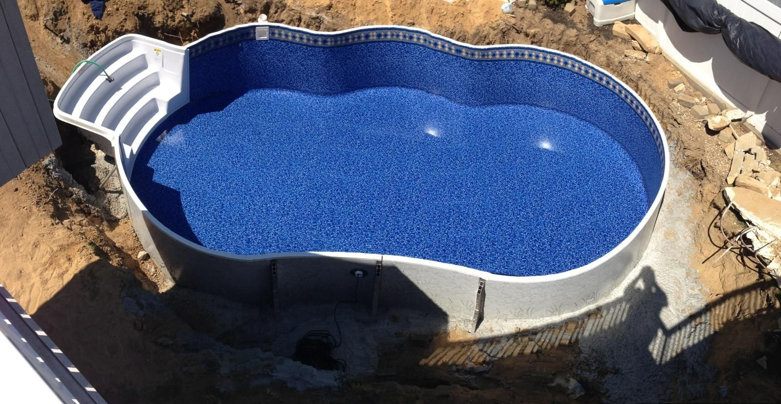 Before Its Backfilled 16x28 Metric Radiant Freeform Pool