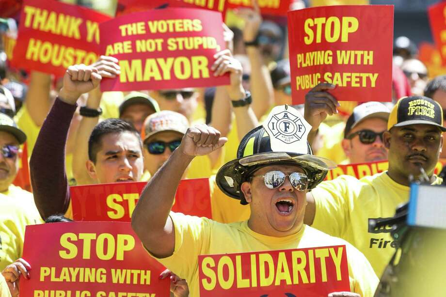 Houston firefighters march on City Hall over Prop B raises ...
