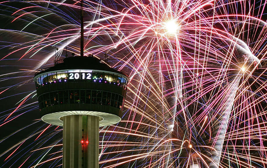 Big bash welcomes new year   San Antonio Express News Fireworks explode around the Tower of the Americas during the Celebrate San  Antonio event Sunday Jan