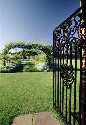 Open Wrought Iron Gate At Beningbrough Hall Leading To A