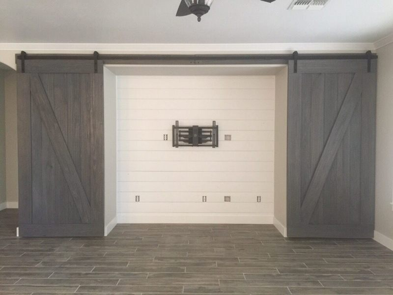 Shiplap media wall with custom barn doors   Yelp Photo of Lollis Custom Interiors   Phoenix  AZ  United States  Shiplap  media wall