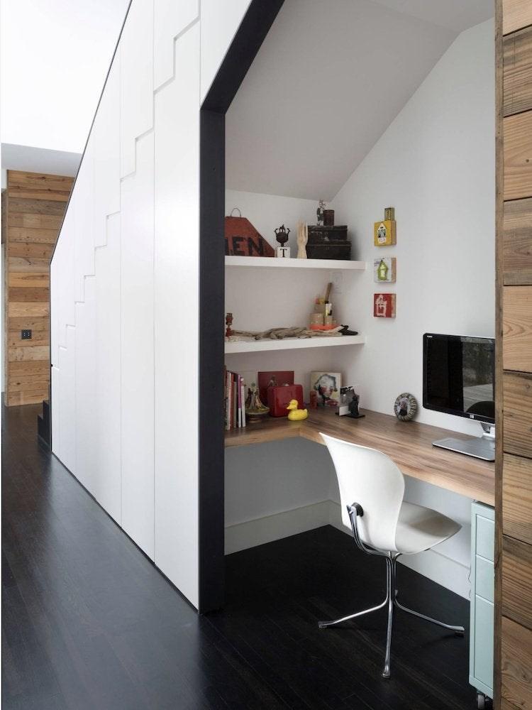 Under Stair Storage 17 Clever Ideas Bob Vila | Kitchen Under Stairs Design | Stair Case | Wet Bar | Basement Stairs | Living Room | Basement Kitchenette
