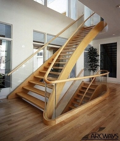 Staircase Railing 14 Ideas To Elevate Your Home Design Bob Vila | Wooden Hand Railing Designs | Light Wood | Residential Industrial Stair | Wood Panel | Decorative Glass | Scandinavian