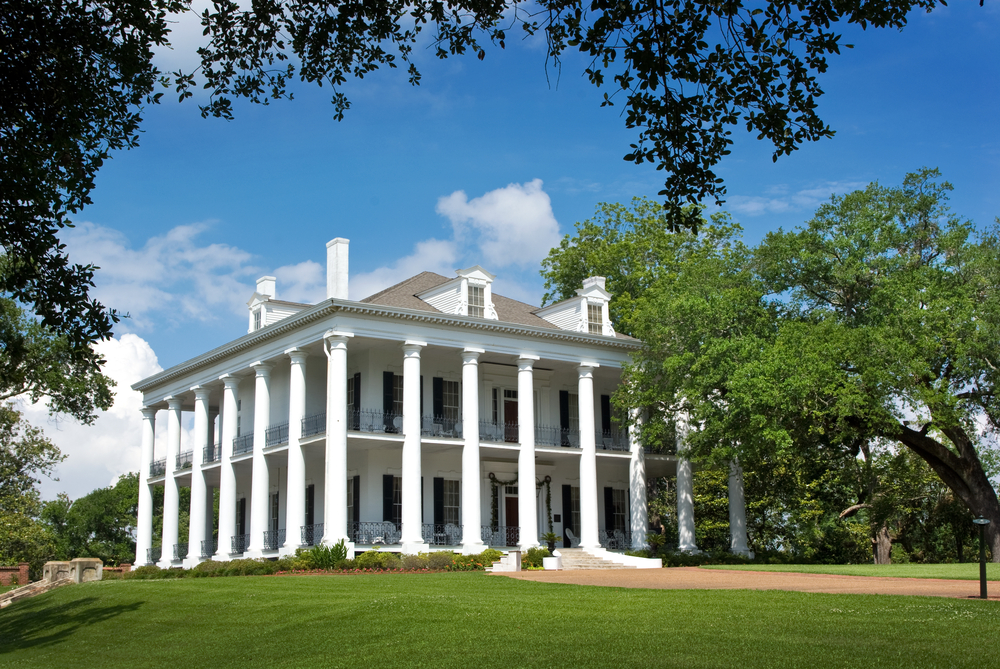 40 Plantation Home Designs   Historical   Contemporary Dunleith Plantation in Natchez  Mississippi  Classic Greek revival southern  mansion with pillars wrapping entirely