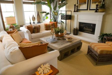 25 Cozy Living Room Tips and Ideas for Small and Big Living Rooms Bright and colorful living room design with off white sofas decorated with  orange and brown