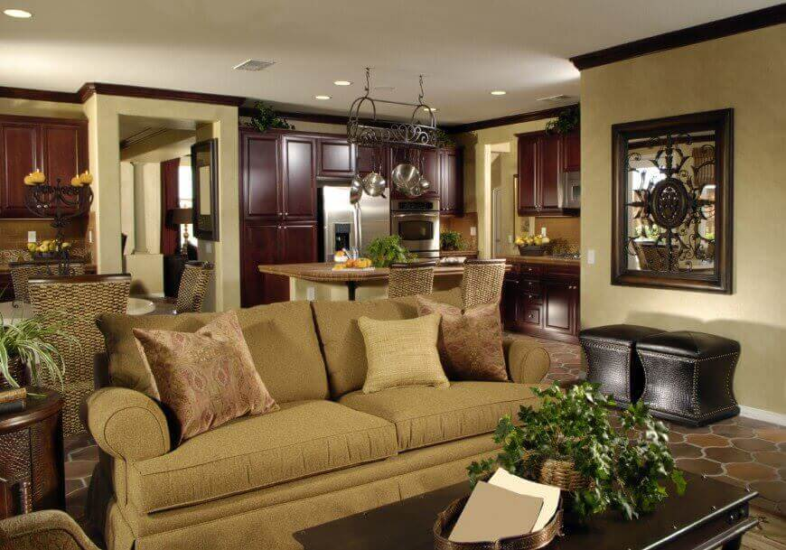 36 Elegant Living Rooms that are Richly Furnished   Decorated Lush cherry wood cabinetry throughout the kitchen area in this shared open  space contrast with beige