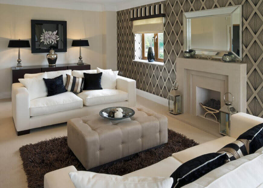 36 Elegant Living Rooms that are Richly Furnished   Decorated Modern look living room features white sofas with dark decorative pillows  facing over rectangular grey ottoman