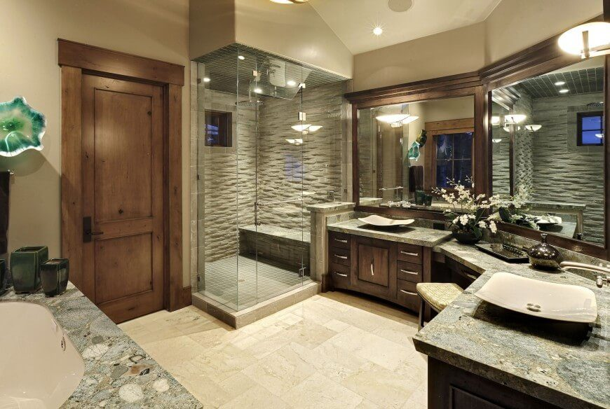 34 Large Luxury Master Bathrooms that Cost a Fortune in 2018 This dynamic room is full of breath taking granite countertops and dark  wood work