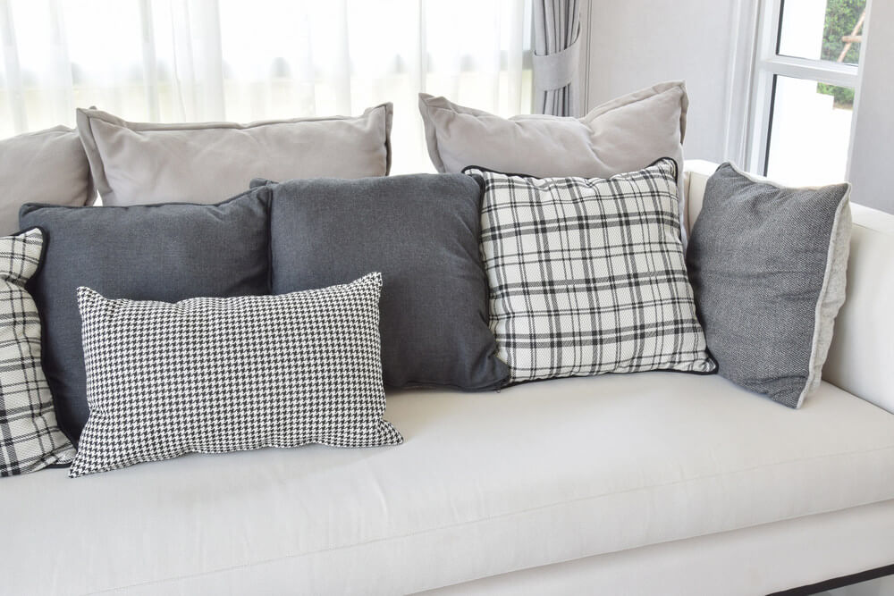 35 Sofa Throw Pillow Examples  Sofa D    cor Guide    Home Stratosphere White sofa with charcoal grey and white throw pillows in a variety of  patterns including geometric