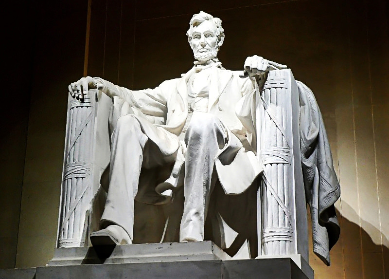 Lincoln seated between fasces (Lincoln Memorial, Washington D.C.)