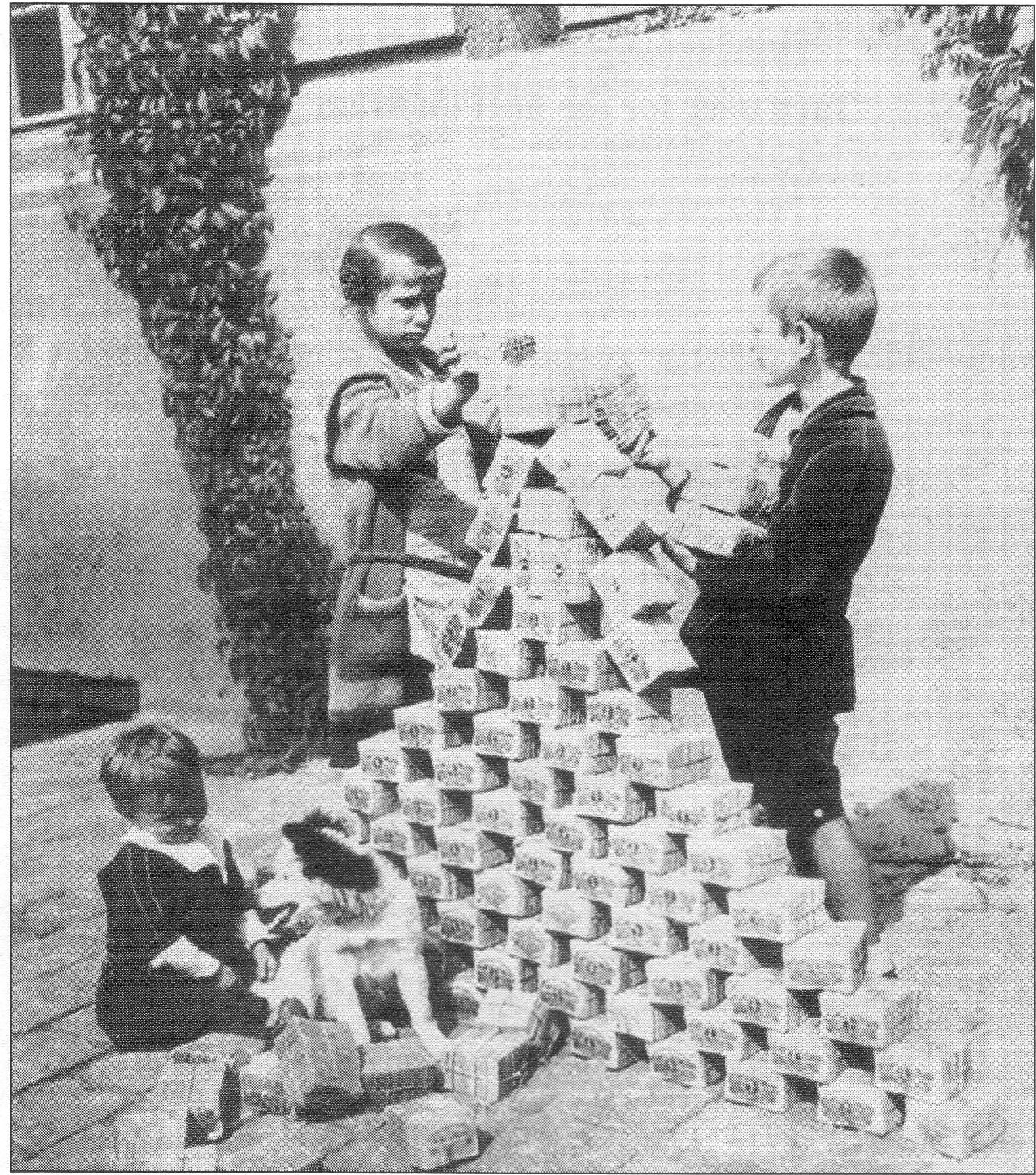 Kids Stacking Worthless Bricks of German Dollars